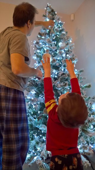 Ethan And I Reaching Putting Up The Christmas Tree Dec 2018