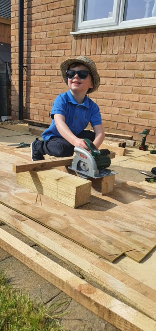 Ethan Cutting Building Bird House April 2020