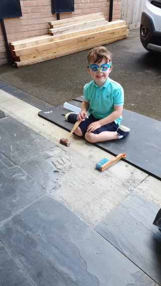 Ethan Smashing Fixing Broken Garage Floor Tile June 2020