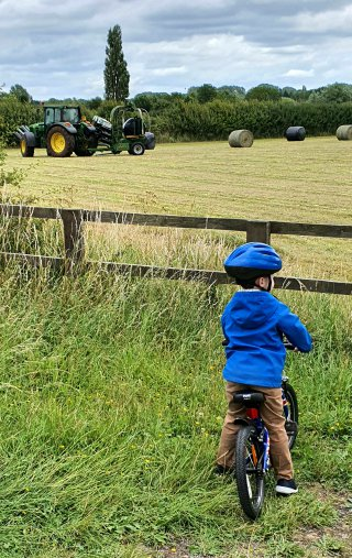 Ethan Watching Tractor Baling Hay July 2020