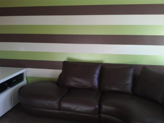 Lounge Striped Wallpaper With Sofa In