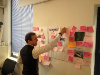 Me Putting Up Postit Retro Feb 2014