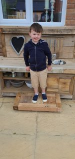 Ethan On The Finished Mud Kitchen Step June 2020